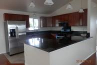 $1500 3/2 Laminate floors. All solar appliances. Covered garage doors.
